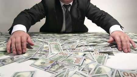 жадный : Greedy business person grabbing lot of hundred dollar bills