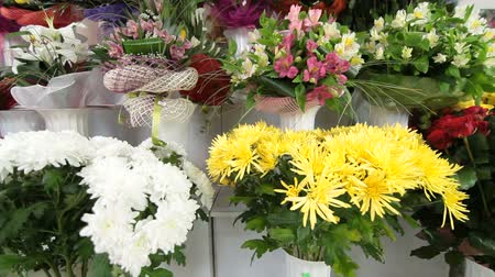 floral composition : Flower shop interior with floral arrangements and bouquets Stock Footage