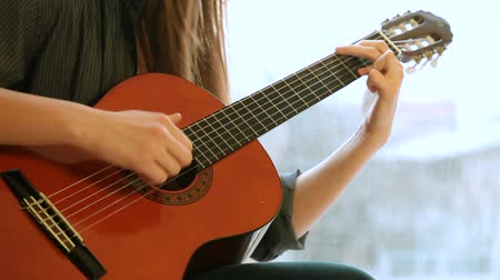 acoustical : Teen Girl Playing Guitar At Home. Close-Up