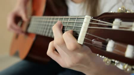 acoustical : Young Girl Playing Guitar Close-up