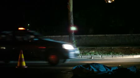 imprudence : Dead person lying on a street after road accident at night Stock Footage