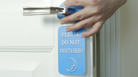 teszi : Blue hanger Please Do Not Disturb on the door of hotel room