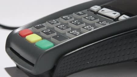 prepaid : Person using credit card processing terminal closeup