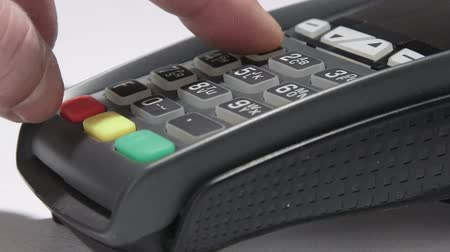 prepaid : Hand dials the pin code into credit card reader