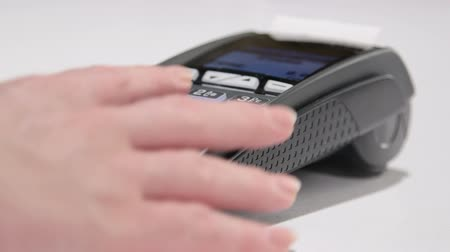prepaid : Swiping card through credit card terminal and printing receipt Stock Footage