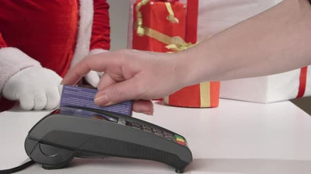 prepaid : Santa Claus customer with gifts boxes paying by credit card Stock Footage