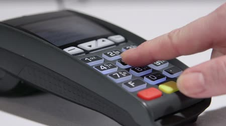 prepaid : Dolly: Person using credit card payment terminal