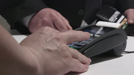 cheque : Person using credit card processing terminal in Ukraine Stock Footage