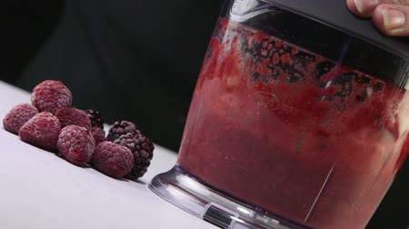 congelado : Dolly: Grinding frozen raspberry strawberry and blackberry using stick hand blender Vídeos
