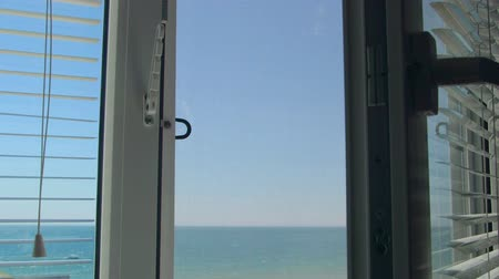 persiana : Sea view through the open white window
