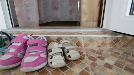 felpudo : family shoes at the entrance to hotel room at the beach seaside resort