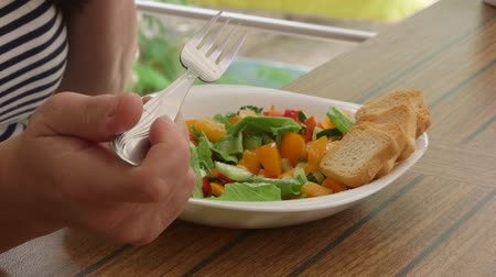 salad : Woman eating summer vegetable salad outdoors Stock Footage