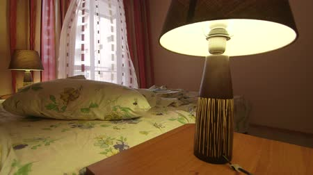 nepořádek : Wind blows the curtains in bedroom of a hotel room with unmade bed