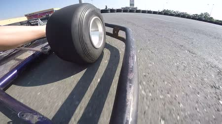 stopa : Go-kart front wheel rushing on outdoor kart circuit PoV