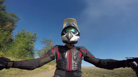 lovas : Point of View: Enduro rider in motorcycle protective gear riding bike on dirt track