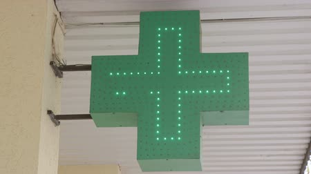 çapraz : Pharmacy neon sign in front of drugstore closeup Stok Video