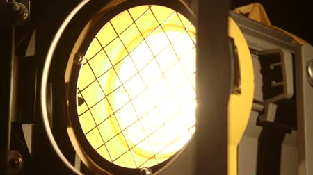 sel : Video studio fresnel lens spot light with metal shutters close-up dolly shot