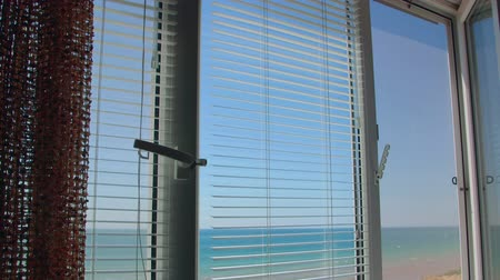 persiana : View from the open window with blinds on the sea in summer Stock Footage