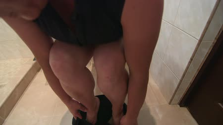 уборная : Woman using digital tablet computer while sitting on a toilet in bathroom Стоковые видеозаписи