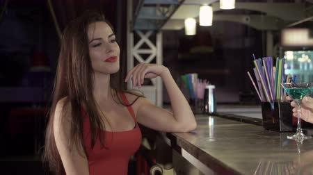 жизнь : Young elegant woman ordering drink at bar counter in nightclub