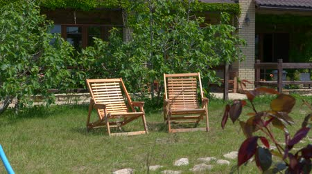 deck chairs : Two outdoor wooden lawn chairs in private house garden on a summer day