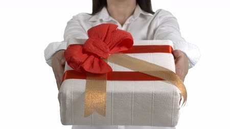tenso : Woman holding Christmas present. Close-up of female hands giving gift box on white background. 4k footage PNG with alpha channel Vídeos