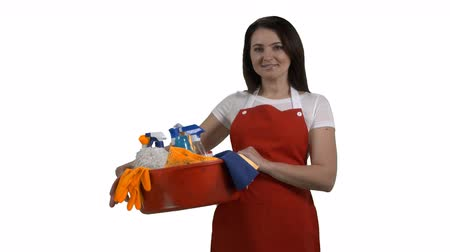 sprzataczka : House cleaning service worker or housewife with washing fluids and rags on white background. Cheerful woman holding cleaning tools and products in washbowl. 4k footage PNG with alpha channel