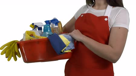 houseclean : House cleaning service worker or housewife with washing fluids and rags on white background. Cheerful woman holding cleaning tools and products in washbowl. 4k footage PNG with alpha channel