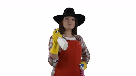 houseclean : Housewife like a cowboy doing housework spraying detergent on white background. House cleaning service worker holding glass cleaner as gun. 4k footage PNG with alpha channel