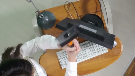 sinir : Angry woman office worker destroying desktop computer with sledgehammer trying to reduce stress. View from above