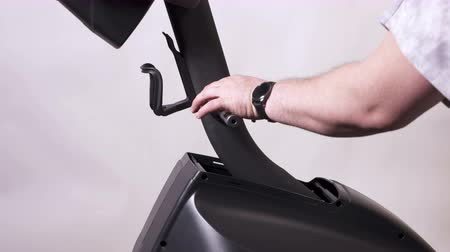 elliptical : Elliptical trainer assembly process at home. Installing wave washers onto the handle bar axle. Stock Footage