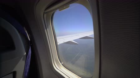 View through a passenger airplane window flying over the Crimea. Aircraft Boeing. Sunny day and clear sky.