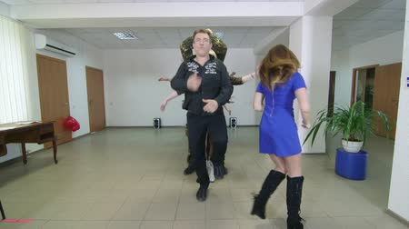 SIMFEROPOL, CRIMEA - CIRCA OCTOBER 2015: Funny business colleagues performing Macarena line dance in small office lobby. Stock Footage