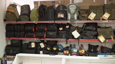 pan shot : Interior of camera store. Shelves with camera bags, backpacks and cases for sale