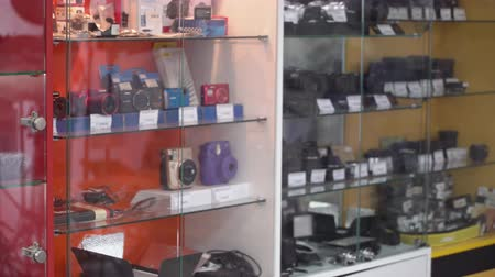 canon : Interior of camera store. Display cases with new digital cameras and accessories