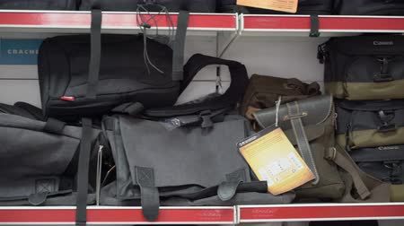 canon : Interior of camera store. Camera bags, backpacks and cases for sale on display Stock Footage