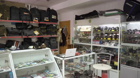 flash sale : Interior of camera store. Shelves with photographic equipment and camera bags