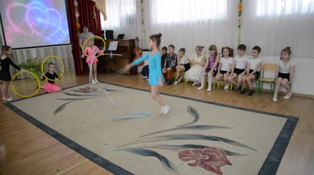 sznurek : KALININGRAD, RUSSIA - APRIL 05, 2018: A demonstration sports performance with a tape. A morning performance in kindergarten