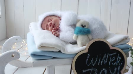 first born : The newborn boy wakes up in the winter photoson