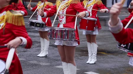 playing band : Majorets are lined and knocking out the melody. Street performance on the occasion of the holiday. Rainy day