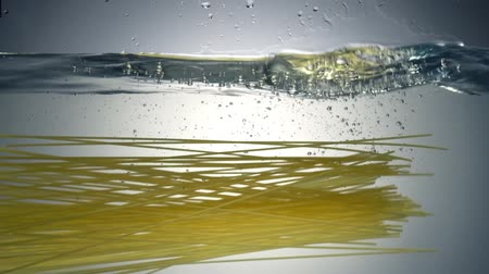 massa : Spaghetti falling into water. Shooting from the water bottom. Slow motion 120 fps.