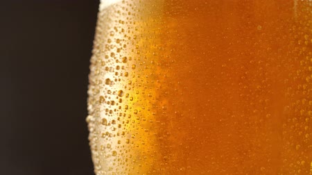 pivo : Glass of beer. Close up 4K video. Black background.