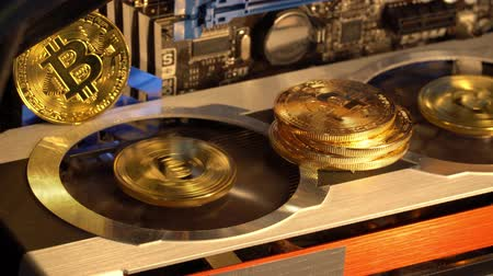 Coins golden bitcoin appear when mining on a video card. Animated 4K video.