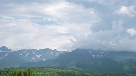 Time Lapse 4K Video in the Mountains range High Tatras in Poland with cumulus clouds. Wideo