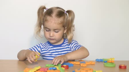 toy : child little girl playing plastic toys at home or kindergarten.children designer. Stock Footage