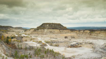 экскаватор : The landscape in a quarry. Aerial view of the quarry in autumn day. Time Lapse. Стоковые видеозаписи