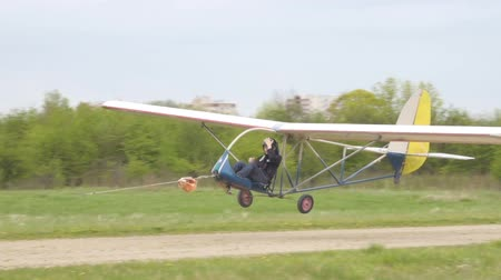 aircrew : Young people learn to fly on a makeshift plane. Takeoff and landing, flight on a homemade glider. Stock Footage