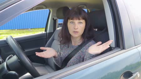 bewilderment : Young angry woman in perplexity sitting in the car. Stock Footage
