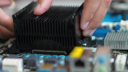 chipset : Removing And Replacing CPU cooler on modern PC computer motherboard. CPU on the motherboard. Stock Footage