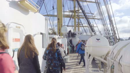 dia : Tourists on excursions walk along the deck of the ship sailboat Kruzenstern. Kaliningrad - September 2017 Russia Stock Footage